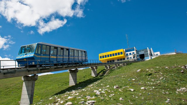 In the picture the blue train which is connecting st. Moritz and corviglia.