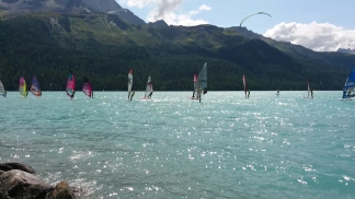 Windsurfers sailing towards the start line
