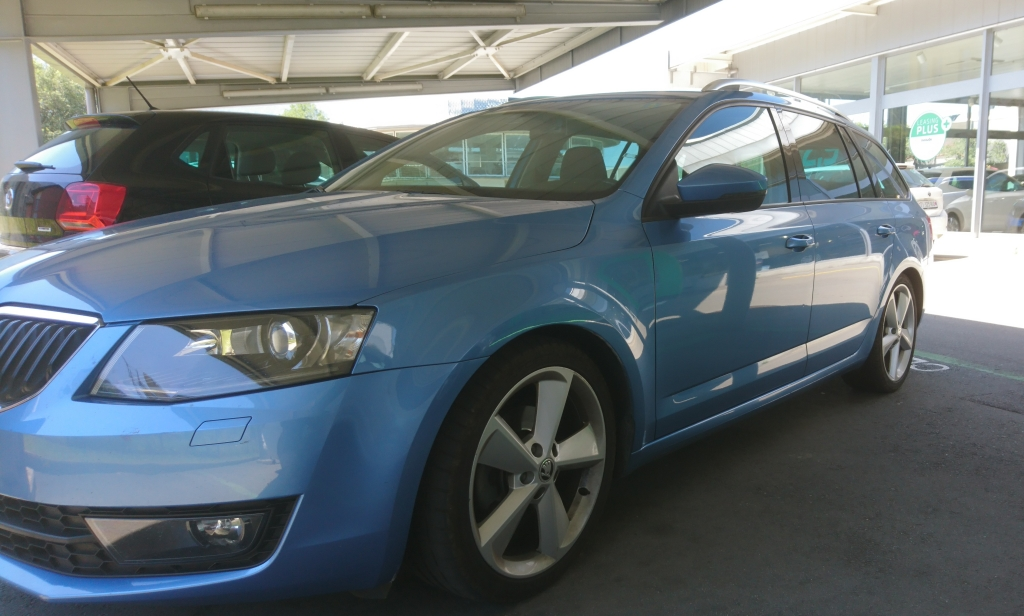 Picture depicts a sky blue Skoda Octavia (2014).